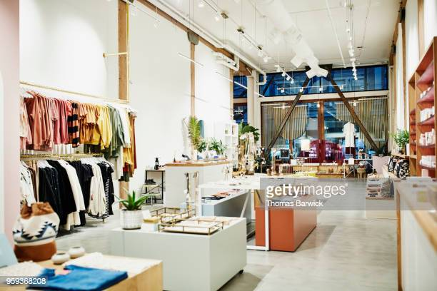 interior of clothing boutique - focus on background stock pictures, royalty-free photos & images