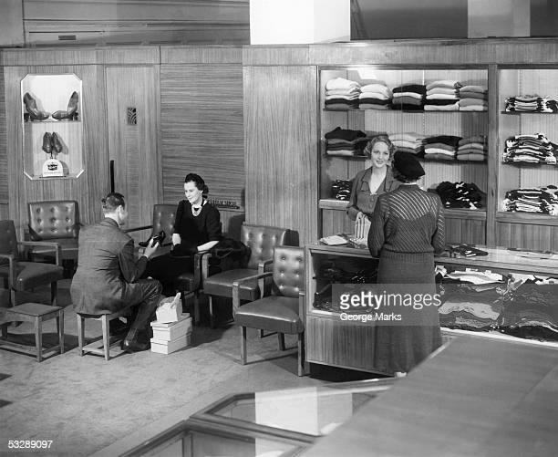 interior of clothing store - 20th century stock pictures, royalty-free photos & images