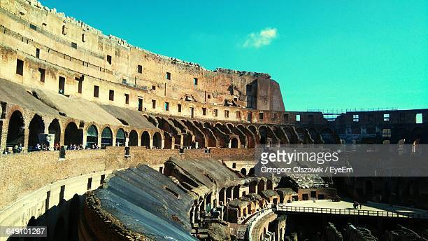 interior of coliseum on sunny day - inside the roman colosseum stock photos and pictures