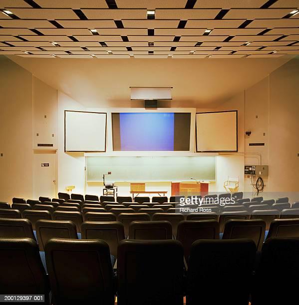 interior of college audio visual classroom, rear view - overheadprojector stockfoto's en -beelden
