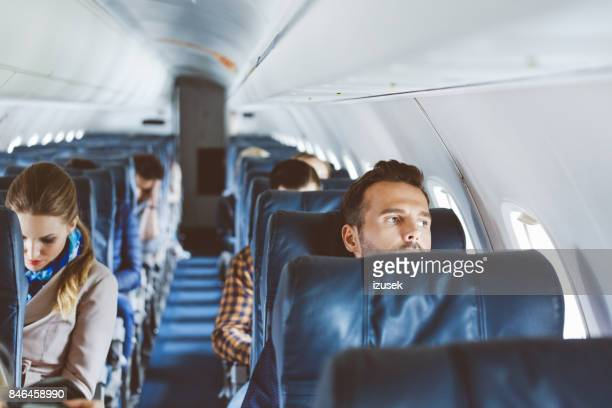 interior of commercial airliner cabin - passeggero foto e immagini stock