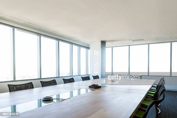interior of empty brightly board room in a financial institution. - shareholder's meeting stock photos and pictures