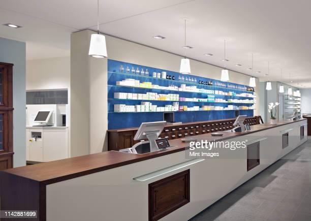 interior of empty modern pharmacy - apotheke stock-fotos und bilder