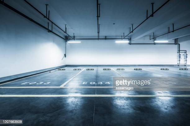 interior of empty parking lot of shopping mall - 駐車 ストックフォトと画像