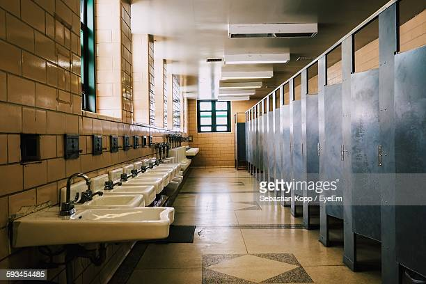 interior of empty public restroom - public restroom stock pictures, royalty-free photos & images