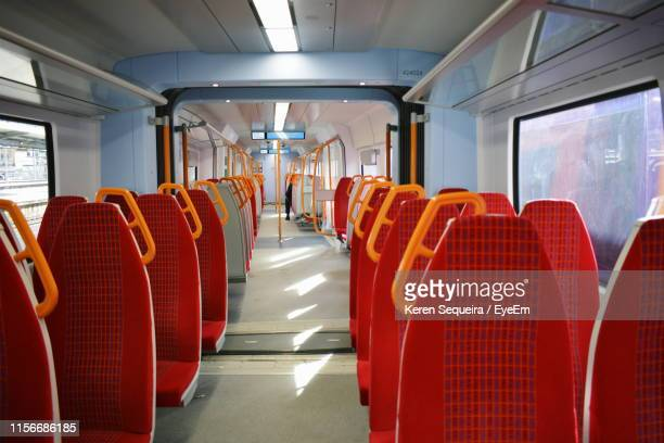 interior of empty seats in train - sparse stock pictures, royalty-free photos & images