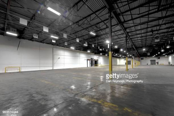 interior of empty warehouse hdr - roller shutter stock pictures, royalty-free photos & images