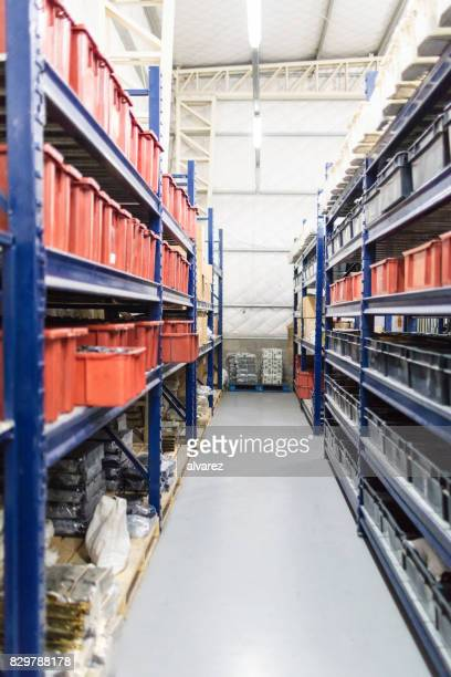 Interior of factory warehouse with long shelves