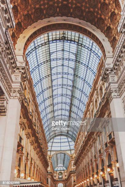 interior of galleria vittorio emanuele ii - milan street style stock photos and pictures