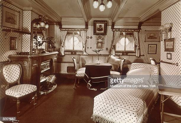 Interior of German Empress Augusta Victoria's sitting room on board the German Imperial Yacht the Hohenzollern 1902 The bed chairs and end table are...
