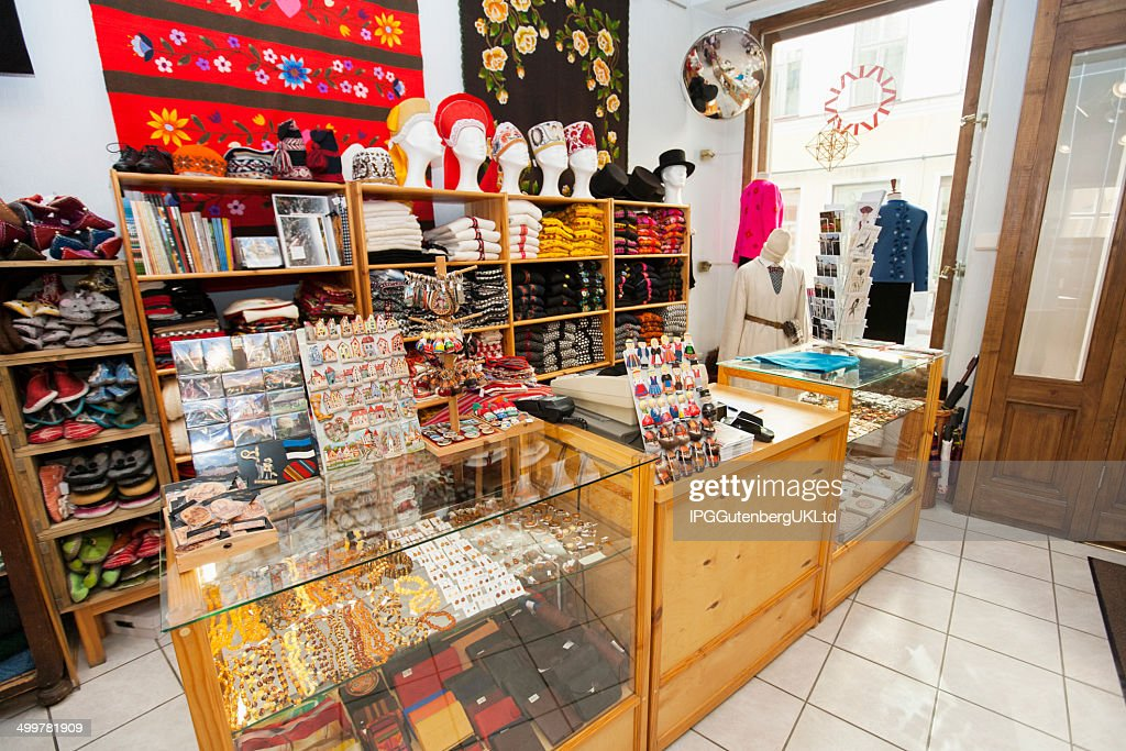 Saleswoman Helping Customer; Christmas Shopping; Interior Of Gift Store ...