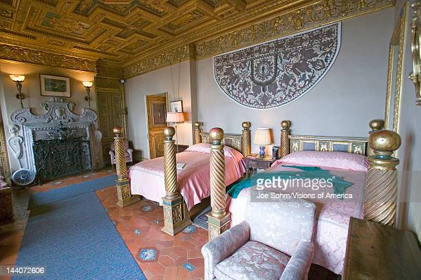 Interior of guest bedroom with displayed antique clothing of the day at Hearst Castle America's Castle San Simeon Central California Coast