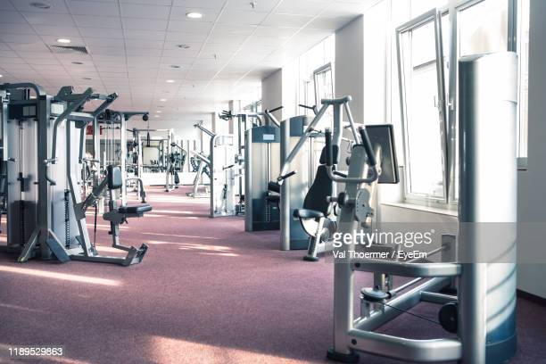 interior of gym - health club stock pictures, royalty-free photos & images