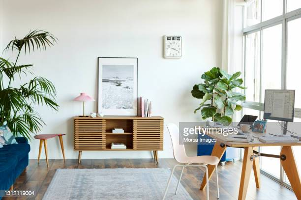 interior of home office with computer at table - desk stock pictures, royalty-free photos & images