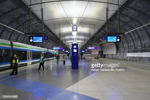 interior of illuminated subway station - subway station stock pictures, royalty-free photos & images