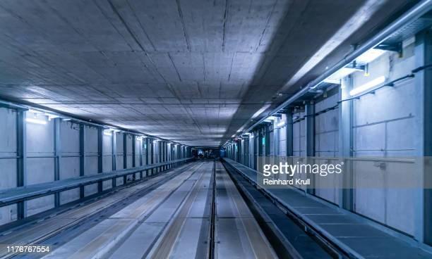 interior of illuminated subway station - lungo foto e immagini stock