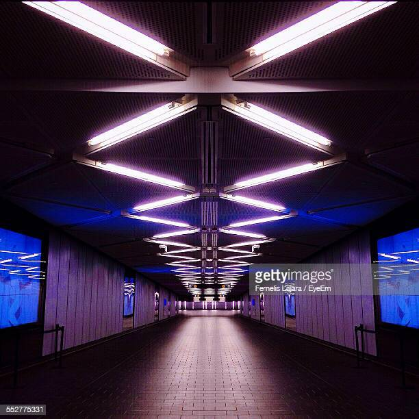 interior of illuminated subway station - fluorescent light stock pictures, royalty-free photos & images