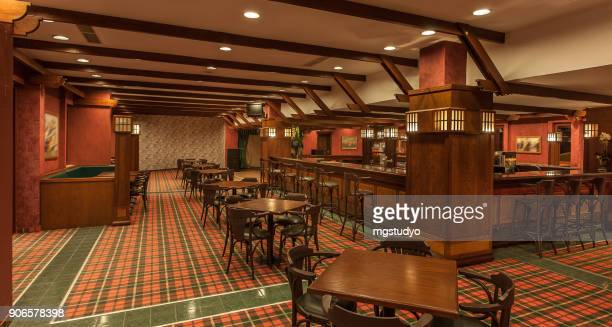 interior of irish a pub - pub stock pictures, royalty-free photos & images