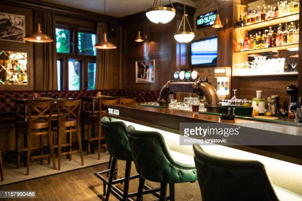 interior of irish pub - pub stock pictures, royalty-free photos & images