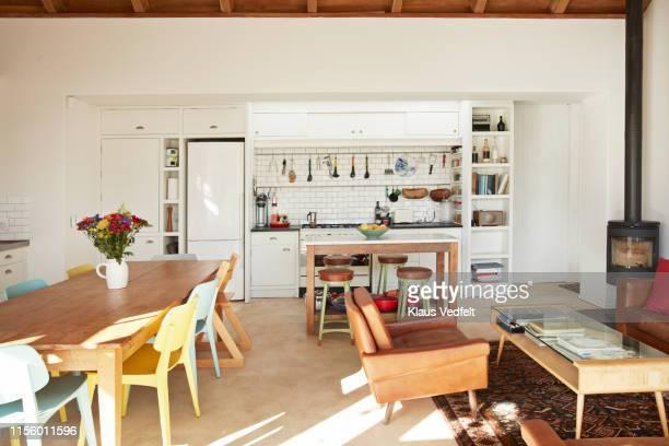 interior of kitchen & living room at home - blanco color fotografías e imágenes de stock