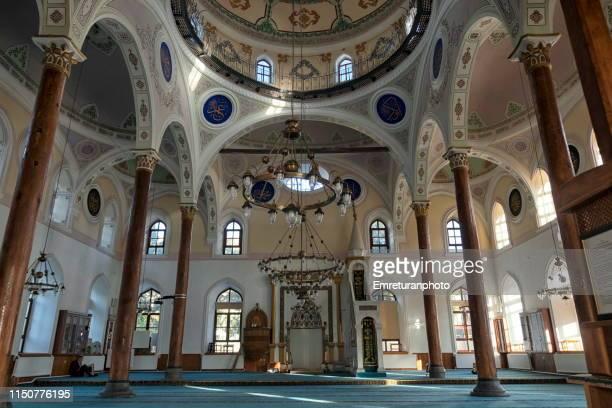 interior of kutlubay mosque with one person praying in isparta,turkey. - emreturanphoto stock-fotos und bilder