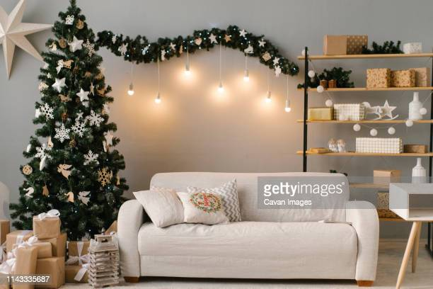 interior of living room with christmas decorations and presents - hausdekor stock-fotos und bilder
