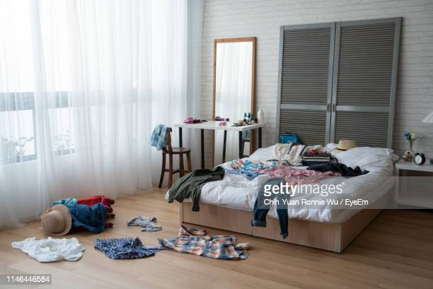 interior of messy bedroom - bedroom stock pictures, royalty-free photos & images