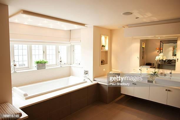Interior of modern bathroom and soaking tub