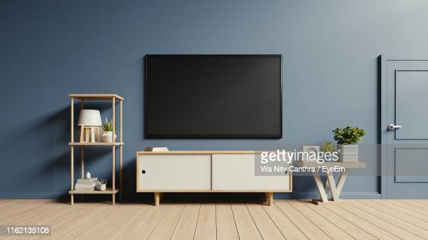 interior of modern home with furniture - living room stock-fotos und bilder