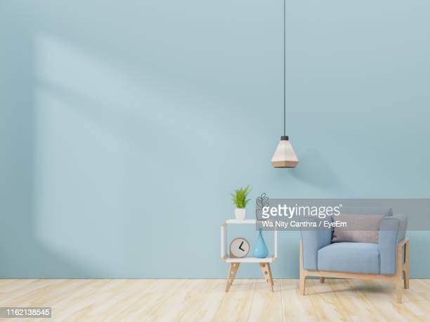interior of modern home with furniture - pendant light stock pictures, royalty-free photos & images