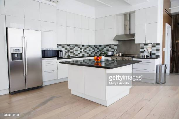interior of modern kitchen in loft apartment - garbage can stock photos and pictures