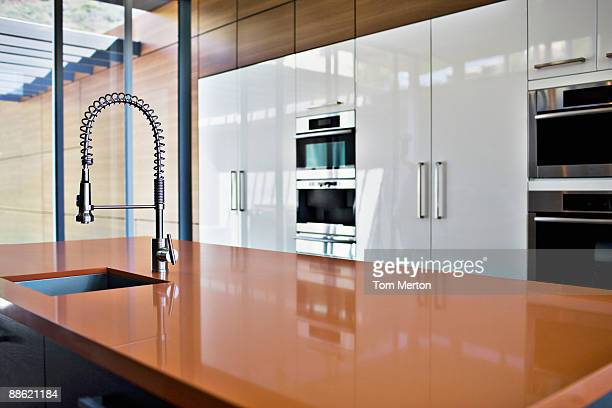 Interior of modern kitchen with spray nozzle