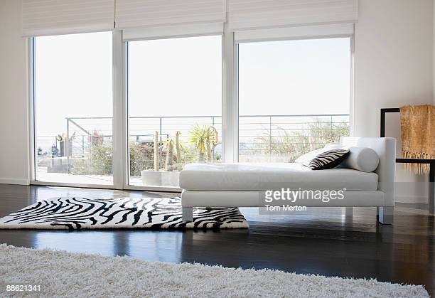 interior of modern living room with glass walls - geographical locations stock pictures, royalty-free photos & images