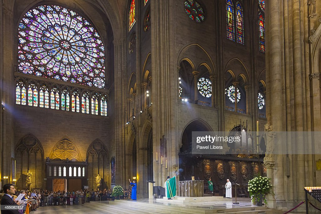 Interior of Notre Dame Cathedral in Paris during mass