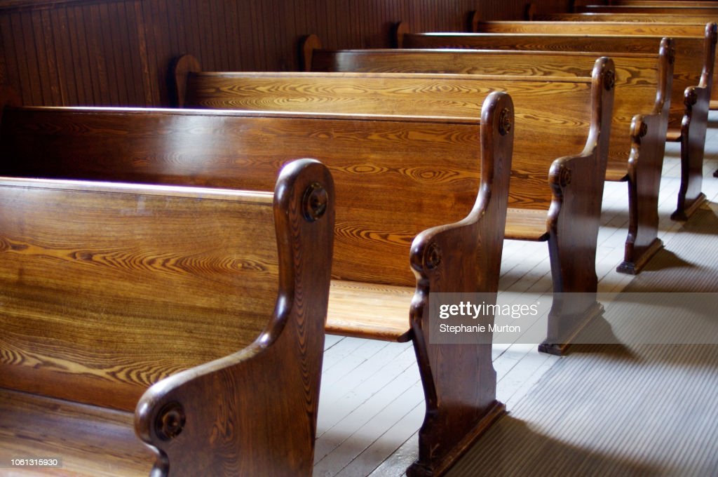 Interior of old church with carved wooden pews : Stock Photo