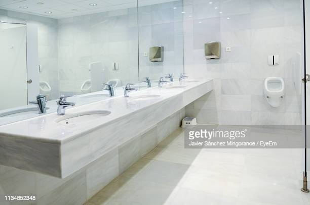 interior of public restroom - public restroom stock pictures, royalty-free photos & images