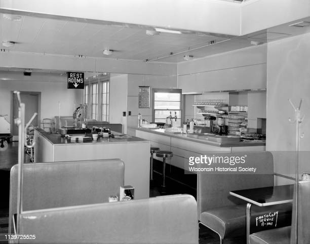 Interior of Roadside Milk Bar with soda fountain service island and booths Shorewood Hills Wisconsin September 11 1945 The business was located on...