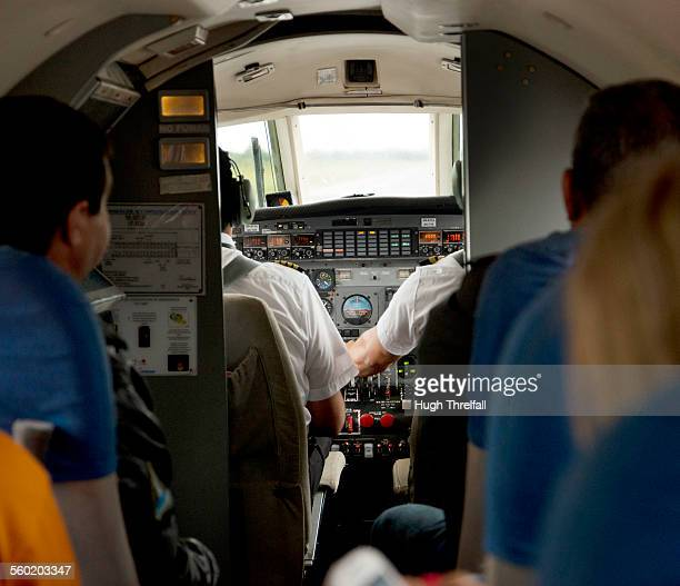 interior of small commercial flight in bolivia - hugh threlfall stock pictures, royalty-free photos & images