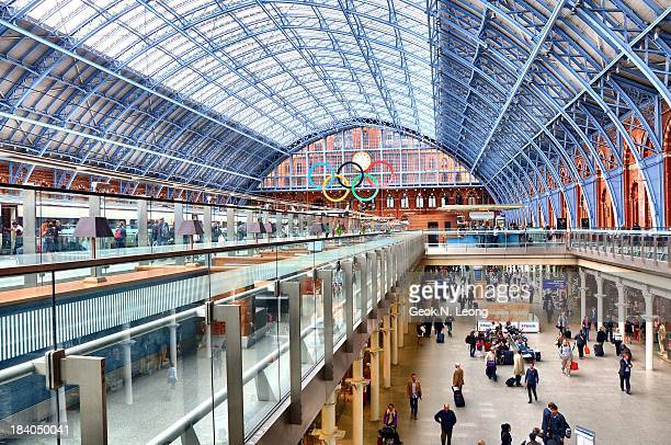 Interior of St Pancras International, central London railway terminus with Victorian architecture, two levels, people, restored station with 15...