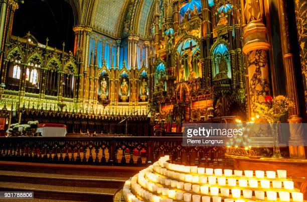 interior of the basilica of notre dame in montreal, canada. - notre dame de montreal stock photos and pictures