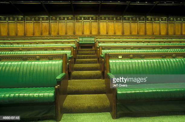 Interior of the chamber of the House of Commons in the Houses of Parliament / Palace of Westminster This detail shows the green leather benches of...