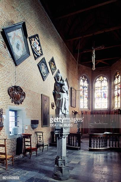 Interior of the Chapel with a stone Madonna and Child statue attributed to Andre Beauneveu 14th century EcaussinnesLalaing Castle Flanders Belgium
