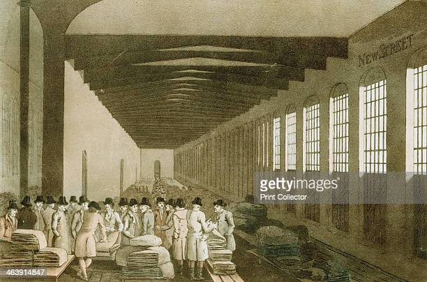 Interior of the Cloth Hall Leeds 1814 This building was one of the great centres for the sale of woollen cloth Merchants are bargaining over...
