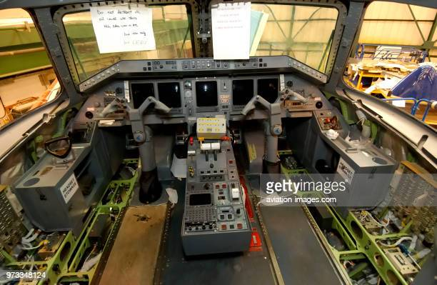 interior of the cockpit of the British Airways CitiExpress Embraer ERJ145 during maintenance in the hangar