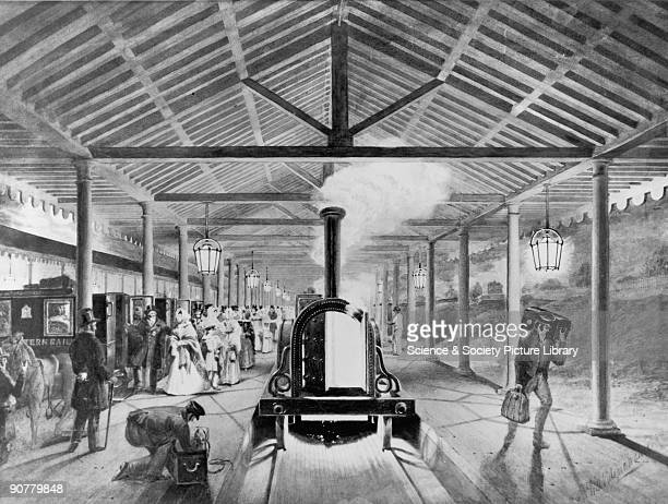 Interior of the Great Western Railway's original Paddington station London c 1840 Print of watercolour showing a steam locomotive porters carrying...