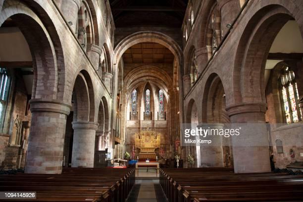 Interior of the knave towards stained glass windows in Church of England denomination Shrewsbury Abbey in Shrewsbury United Kingdom The Abbey Church...