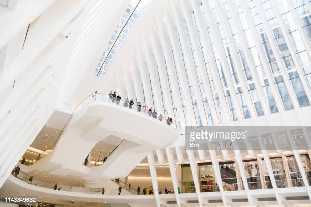 interior of the oculus transportation hub, new york - building atrium stock pictures, royalty-free photos & images