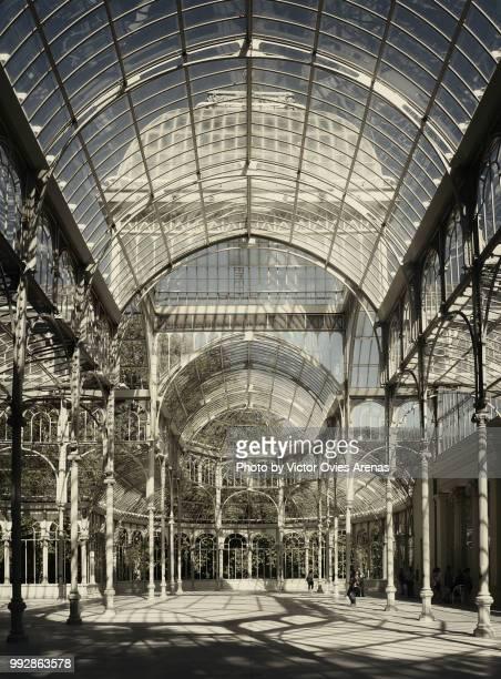 interior of the the palacio de cristal (crystal palace) made of glass and metal in madrid's buen retiro park - victor ovies fotografías e imágenes de stock
