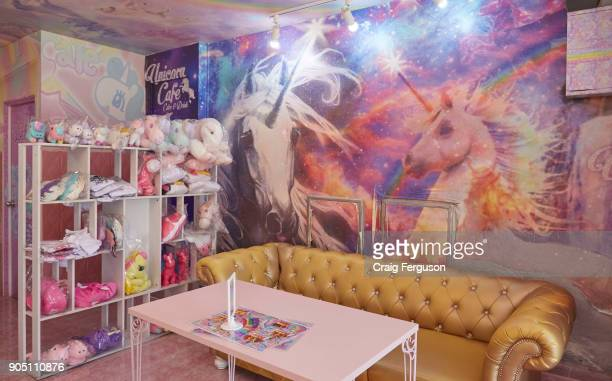 Interior of the Unicorn Cafe The theme cafe in Bangkok features unicorn murals plush toys and figurines as well as unicorn costumes and other...
