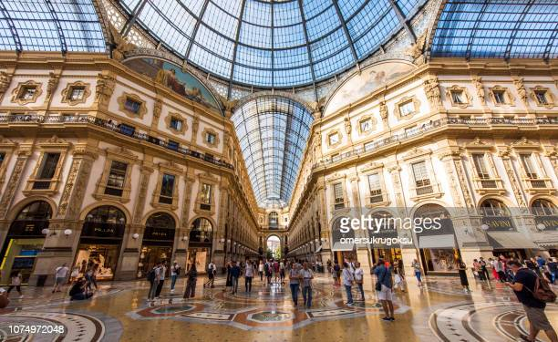 interior of the vittorio emanuele ii gallery on square duomo, in the city center of milan, italy - designer label stock pictures, royalty-free photos & images